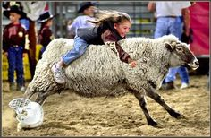 Mutton Bustin' Grip-n-Grin Photo by John Warner -- National Geographic Your Shot