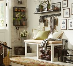 Love this Pottery Barn entry way. Wire baskets, shelves, organization...