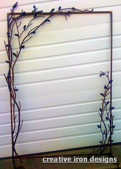 Creative Iron Designs ~ This Iron mirror frame is being used in a cabin in the mountains of North Carolina, we made it to simulate branches and leaves, everything was cut and bent by hand.