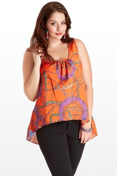 This eye-catching chain print tank is sophisticated and modern. All-over orange print includes pops of stunning light violet, while the drape is easy and flattering, including a shirred neckline and high-low hem. Pair with tailored leggings and gold or orange jewelry to complement the print.