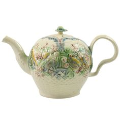 William Greatbatch Creamware pottery Teapot  England  circa 1760  A fine William Greatbatch creamware teapot molded with raised fruit and shells over a basket weave lower section, decorated in underglaze oxide colors