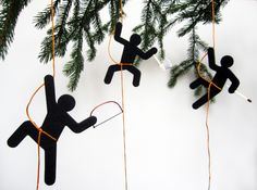 these 'horrible holiday hooligans' by sebastian reymers design are a set of trouble-making christmas ornaments  bring a bit of humor to the stress and seriousness of the holiday season. handmade out of stiffened felt, metal  and wood for the tools, the characters are seen armed with either an axe, saw, or match, as if they were to be  causing some chaos.