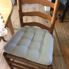 """""""I love my blue strip ticking chair pads. They are very comfortable and look great with my decor. The customer service for this company is excellent! I will be purchasing from them again. Navy Blue Dining Chairs, Ladder Back Dining Chairs, Ladder Chair, Dining Chair Cushions, Striped Chair, Ticking Stripe, Customer Service, Hardwood Floors, Kitchen Decor"""