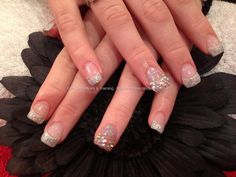 Acrylic nails with Swarovski crystals on tips on ring fingers and glitter gel on tips...oh if only I could afford to do swarovski crystals on my nails...