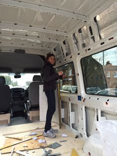 Volkswagen Crafter motorhome conversion on a street in London. Photos showing plywood floor, wall panels, carpet and insulation.