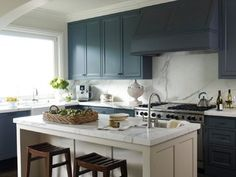 benjamin moore temptation cabinets with Calcatta Gold marble countertops.  Done in a kitchen that opens to the dining room, painted cabinets in a different color like this allows the space to be defined and look like traditional furniture.