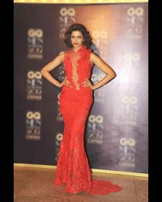 Deepika mesmerised in a red lace Gaurav Gupta gown at the GQ awards in 2012. Everything from her red lips to her updo was fabulous. FOR MORE BOLLYWOOD LATEST NEWS ON MOBLIE CLICK : http://m.biscoot.com