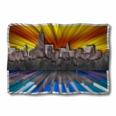"""All My Walls URB00002 New York at Sunset by All My Walls. $410.00. Add a splash of color with our """"New York at Sunset"""" metal wall sculpture. This metal wall hanging brings a new perspective on the Big Apple and consists of two colorful painted metal layers that will brighten up any home's decor. Each metal artwork has an individually hand sanded design that will display a vibrant three dimensional effect that will make your walls shine. Size: 25.5"""" Ta..."""