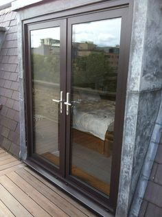 A classic installation to a roof top apartment in a conservation area in central London. Aluminium French doors accurately positioned within existing lead lined openings – perfectly surveyed with no unsightly trims or heavy use of sealants to cover gaps. Aluminium French Doors, Aluminium Windows And Doors, Timber Windows, Steel Windows, House Windows, Steel Doors, Loft Dormer, Installing French Doors, Flat Ideas