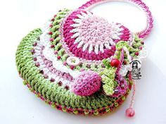 Garden Scene by Vendula Maderska ~ another adorable purse design ~ pattern available on Ravelry