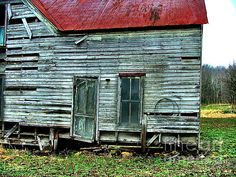 Abandoned home with red roof