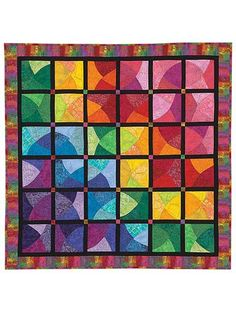"""Fabulous and colorful stash-buster!   Gradations are the key to creating a truly luminescent quality when piecing this marvelous gem! There aren't any points to match, so you don't have to worry about absolute precision when piecing it all together -- success is guaranteed! Approximate finished quilt size is 40"""" x 40""""."""