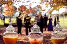 apothecary jars with fall drinks at ceremony