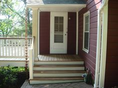 White painted trim with natural wood deck..like the idea of contrast on the steps and railings...
