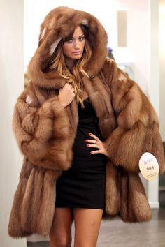 hooded sable fur coat It would be sooooo warm.  I'd look very large in it but gosh sakes I 'd love it!