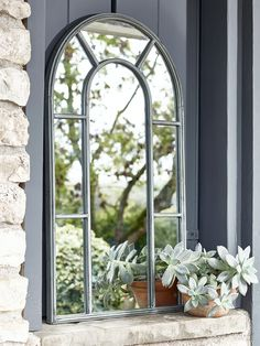 With a soft arched top in a distressed zinc effect finish, our small iron mirror will add new dimensions to your outside space. Reminiscent of chapel windows, our vintage inspired mirror is perfect for smaller spaces and includes a hook on reverse for hanging indoors or out.