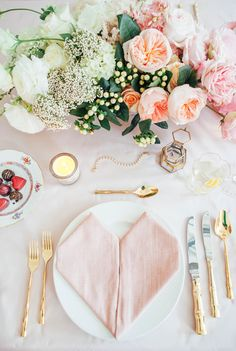 Elegant + pastel Valentine's Day table scape - gold silverware and pastel pink napkins {Courtesy of Rue Magazine}