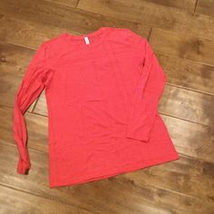 LULULEMON Long Sleeve Top Vibrant red/orange color with detailed stitching on the front, back and arms (see pic). lululemon athletica Tops Tees - Long Sleeve