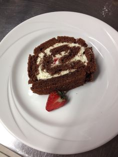 Chocolate and strawberry roulade. This fluffy loveliness is filled with fresh cream and diced strawberries. ❤️