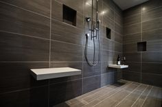 Interior of the walk in shower. Floating Caesarstone benches. Large format tile. Kelli Walden, Allied ASID Niwot Interiors.