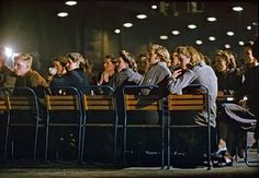 A view of the audience during lunchtime entertainment in a war workers' canteen