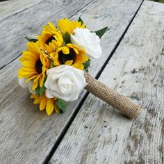 Check out this item in my Etsy shop https://www.etsy.com/listing/460653502/bridesmaid-bouquet-with-pearl-sunflower