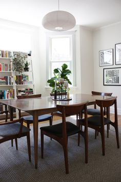 midcentury modern dining room with white shelves. Marti & Jarrod's Graphic Modern Home