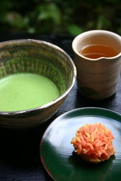 Wagashi (traditional Japanese sweet) and matcha tea, ready to serve in a beautiful teacup.