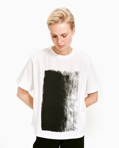 The Vaikutus t-shirt is made of cotton and it carries the black and white Kuiskaus (Whisper) pattern as a placement print. Normal Body, Black Tops, Black And White, Marimekko, Body Shapes, T Shirts For Women, Mens Tops, Clothes, Whisper