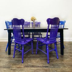 "Daisy's Distressed Designs on Instagram: ""Finished this fun dinning set for Sandy! #blackdiningtable #purplediningchairs #bluediningchairs #handpaintedwithlove💕…"" Purple Dining Chairs, Table And Chairs, Dinning Set, Daisy, It Is Finished, Hand Painted, Fun, Instagram, Design"