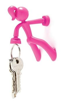 Placez Key Petite sur n'importe quelle surface métallique et elle se fera un plaisir de porter vos clés. Supporte le poids de 30 clés. Existe en rouge, rose, blanc et noir.