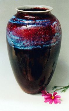 copper red glazed pottery | Photograph of a large porcelain vase with deep red and blue patterns ...