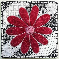 Completed black and white mug rug with a red flower