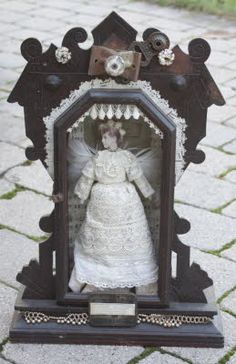 altered art shrine, love the monotone color scheme and the lace versus metal contrast