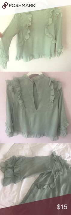Chiffon top Mint/greenish color ruffle chiffon top. Really flowey and light, perfect for spring/summer. Purchased from H&M and worn one time to work. 3/4 sleeve. Perfect condition, brand new top. I just know I'm not going to wear it again. Happy poshing😊 H&M Tops Blouses