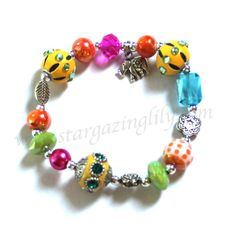 Elephant Charm bracelet with flowers and by stargazinglily on Etsy, $9.75