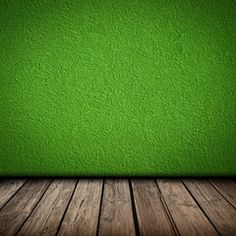 Green wall and wooden floor interior
