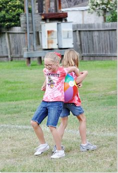 Beach Ball Race- kids work together to hold beach ball between their backs for the first leg of the race, then their sides, then elbows. The field Day Challenge is halfway down on web site & includes water relay, tricycle race, and tug-of-war. Check it out!
