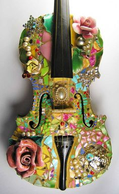 Violin decorated in mosaics and ceramic flowers