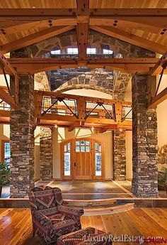 Vaulted ceiling, stacked stone piers, wood trusses and beams