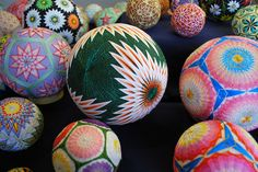 """These stunning embroidered balls called """"temari"""" were made by the prodigiously nimble fingers of a 92-year-old grandmother in Japan. Although she only lear"""