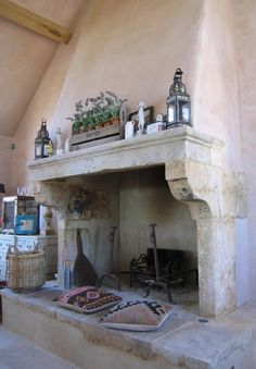This French stone fireplace was purchased from Wharton Antiques for a large, privately-owned property recently built in the Cotswolds.Pictured here is the kitchen fireplace complete with a raised stone hearth that doubles as relaxed seating in front. Rustic Stone Fireplace, Kitchen Fireplace, Rustic Fireplaces, Inglenook Fireplace, Fireplace Design, Artificial Fireplace, French Fireplace, Fireplace Decor, Fireplace