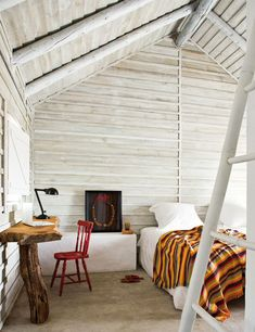 Whitewash, simple, yellow, stripes, red chair, great ceiling and walls.