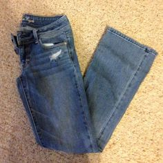American Eagle Distressed Jeans Distressed jeans. Size two. Broken zipper. Purchased cheap that way but they no longer fit me since I've lost weight. Price firm. NO TRADES American Eagle Outfitters Jeans Boot Cut