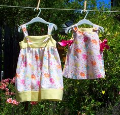 Matching Elephant and Gingham pinafore sun dresses for babies and girls.   Baby - Reversible pinafore with open sides and pink ribbon ties.  Matching bloomers included (0-3M, 3-6M, 6-12M or 12-18M) https://www.etsy.com/listing/234321678/elephants-gingham-baby-dress-reversible $50 Girls - Knotted strap sundress in elephant print with yellow gingham accents (3T, 4T, 5T, 6 years, 7 years or 8 years) https://www.etsy.com/listing/240505903/elephant-gingham-girls-sundress $40