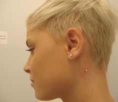 neck dermal behind ear, emphasizes facial structure, seriously contemplating