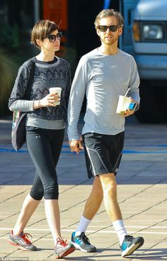 Hold my hand: Anne Hathaway and husband Adam Shulman went for a walk in Larchmont, California, on Friday