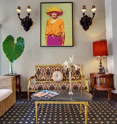 This sitting room blends ornate furniture with modern art and lush plants. (Spotted at the CasaBlanca Hotel in San Juan, Puerto Rico.)