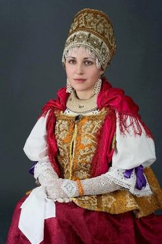 This is an example of what traditionsl Russian clothing looked like for The Czars of Ruska, very expensive and delicate. The average dress of a Czar princess would have about 1.3Kg of  gems and diamonds embroidered to the dresses.