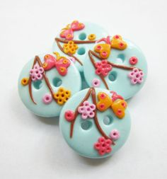 Flowers and butterflies  set of 4 polymer clay buttons  by ayarina, $7.50